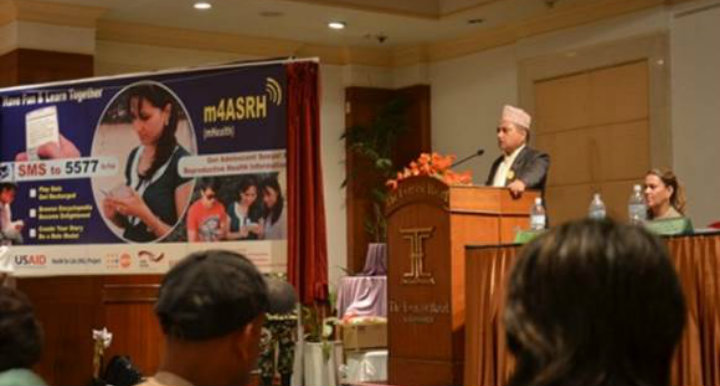 Mr Khaga Raj Adhikari, Minister, Ministry of Health and Population launching 'm4ASRH' (Mobile for Adolescent Sexual & Reproductive Health) on 18 September 2014.