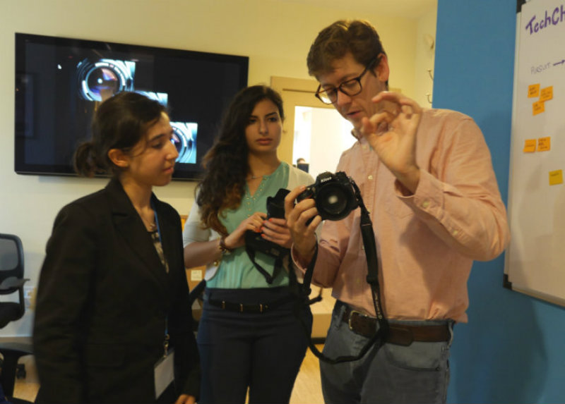 TechGirls Ghada and Nataly   learn about photography with Charlie during their visit to the TechChange office
